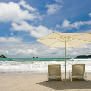Beach umbrellas and chairs, available from our beach services, thru concierge service at EOC