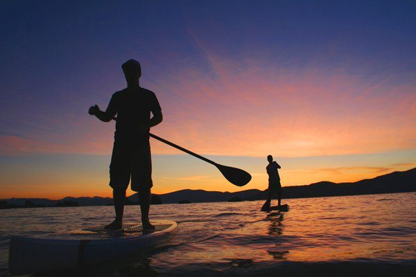 SUP, stand up paddle board tours at night fall! tours and activities offered at EOC